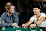 Two poker players concentrating on the game trying to read eachother
