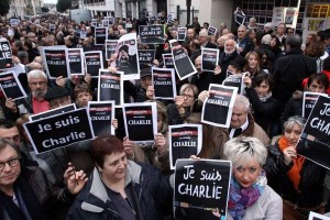 "People hold placards reading ""We are Charlie"" and ""I am Charlie"" during a gathering in Tarbes, southern France, on January 8, 2015, in tribute to the 12 people killed the day before by two gunmen at the editorial office in Paris of French weekly satirical newspaper Charlie Hebdo. The massacre which occured on January 7 is the country's bloodiest attack in half a century and triggered poignant and spontaneous demonstrations of solidarity around the world. Charlie Hebdo is famed for its irreverent views of religion and its decision to publish controversial cartoons of the prophet Mohammed.   AFP PHOTO / LAURENT DARDLAURENT DARD/AFP/Getty Images"
