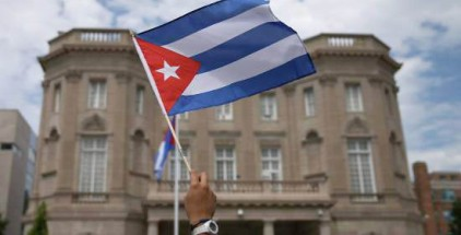 WASHINGTON, DC - JULY 20:  A supporter waves a Cuban flag in front of the country's embassy after it re-opened for the first time in 54 years July 20, 2015 in Washington, DC. The embassy was closed in 1961 when U.S. President Dwight Eisenhower severed diplomatic ties with the island nation after Fidel Castro took power in a Communist revolution.  (Photo by Mark Wilson/Getty Images)