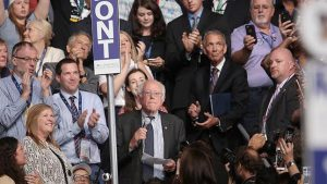 Sen. Bernie Sanders on Tuesday moved for Democrats to choose Hillary Clinton as the party's presidential nominee by acclimation, calling for Democratic unity behind Clinton.