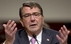 "Defense Secretary Ash Carter — under the direction of the Obama administration — laid out a yearlong implementation plan declaring that ""Americans who want to serve and can meet our standards should be afforded the opportunity to compete to do so."""