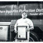 AEMT Billy Eichenbaum with his EMT of the Year award from Inyo County. He was chosen for the award because there was a time when he was the only certified EMT in the area and remained on call day and night. He even had to get other crew members (certified firefighters but not EMTs at that time) to bring him his groceries from town. Photo by Nancy Good