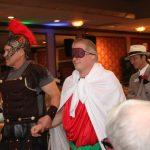 Wayne Allyn Root is lead by the Roman Centurion and followed by his lawyer... Oscar Goodman was not available.