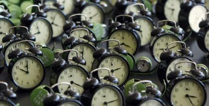 "Clocks are seen during the performance ""tck tck tck"" by Global Campaign for Climate Action at the Barcelona Climate Change Talks, November 4, 2009. REUTERS/Albert Gea"